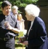 Sister Marian MacDonald with Father Rey at the 4th anniversary celebration on the St. Gerard's lawn.